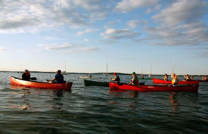 people canoeing on Lake Mendota