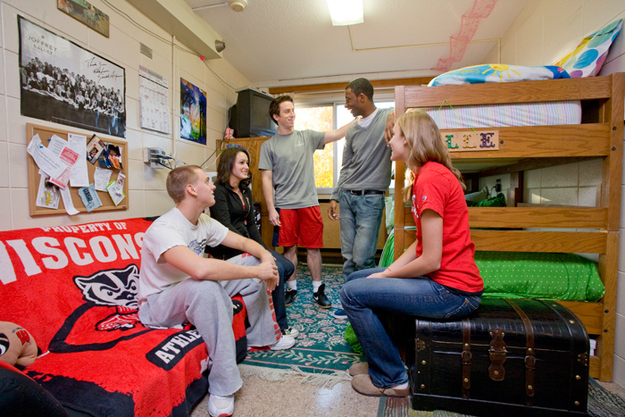 Students talking in a residence hall room